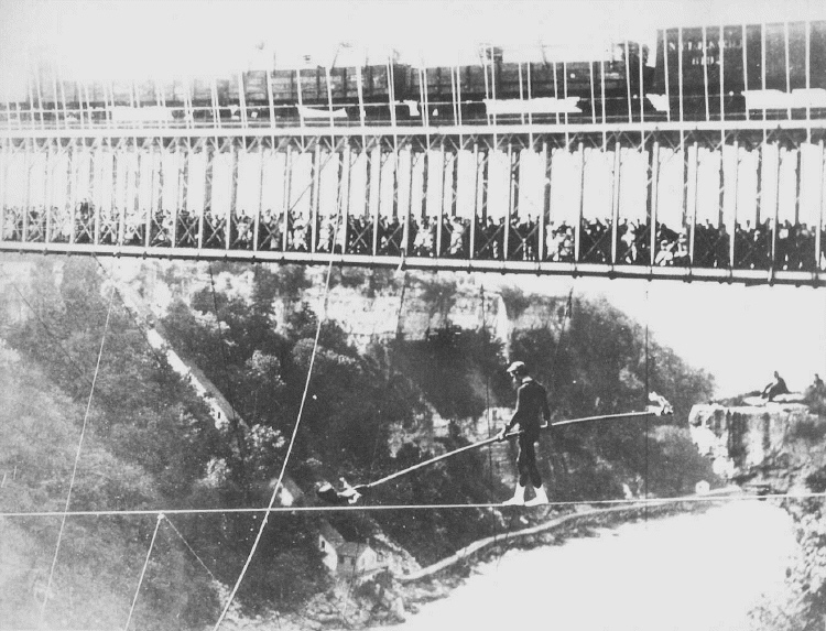 Samuel Dixon Crossing Niagara on a Wire Cable with Railway Suspension Bridge in the Background (image/jpeg)