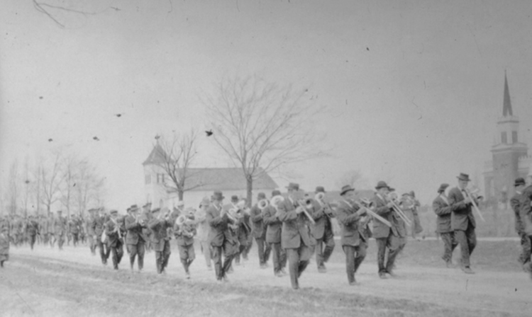 Band and soldiers marching in parade in front of Holy Trinity Anglican Church Chippawa (image/jpeg)