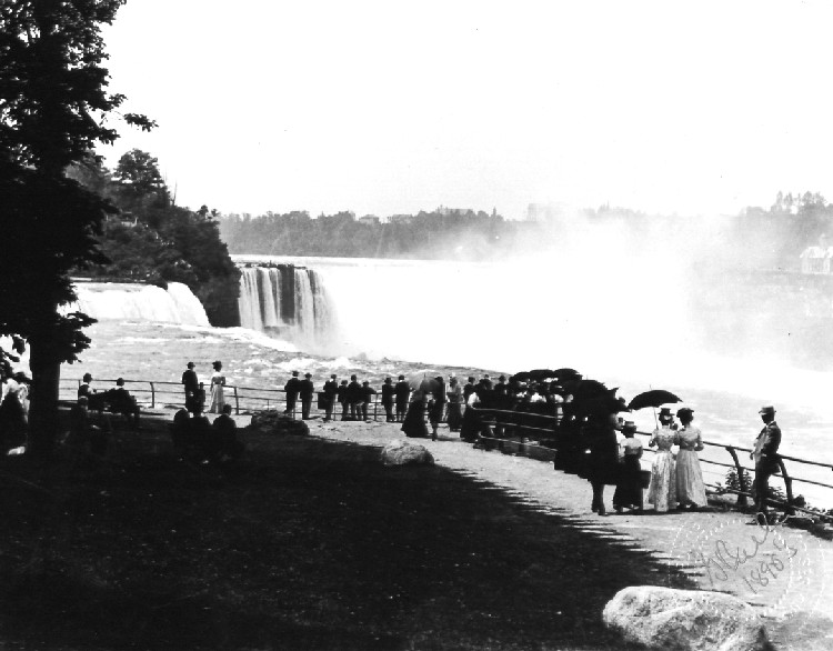 Tourists admiring the American Falls from Prospect Point on Goat Island (image/jpeg)