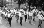 (Thumbnail) Chippawa band marching outside Weightman and Sons Builders Supplies store (image/jpeg)