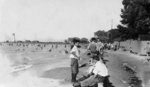 (Thumbnail) Beach at Lakeside Park in Port Dalhousie, lighthouse in background (image/jpeg)