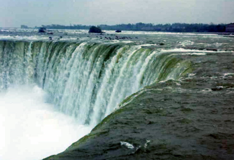 Brink of the Horseshoe Falls, the Upper Niagara River, the old scow  is the upper left (image/jpeg)