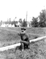 (Thumbnail) Soldier of the 44th Lincoln and Welland Regiment taking aim at unknown photographer (image/jpeg)