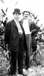 (Thumbnail) 2 Men Standing in a Corn Field (image/jpeg)