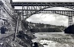 (Thumbnail) Belt Line Car passing under lower Steel Arch and M.C.R. [Michigan Central Railway] Bridges, depth of Gorge 240 ft., Niagara Falls, Canada (image/jpeg)