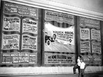 (Thumbnail) Capitol Theatre curtain with advertising for local businesses and shops (image/jpeg)