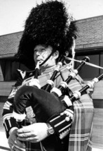 (Thumbnail) Jim Caddir playing the Bagpipes in front of the Niagara Regional Police Station on Morrison Street (image/jpeg)