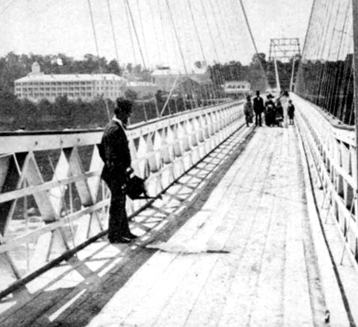 Cleaning the wooden deck of the Fallsview Upper Suspension Bridge Niagara Falls (image/jpeg)