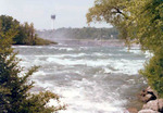 (Thumbnail) Upper Niagara River leading to the Brink of the American Falls Minolta Tower in background (image/jpeg)