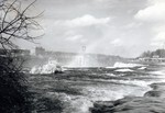 (Thumbnail) Brink of the American falls in Winter - construction of Rainbow Bridge and General Brock Hotel in background (image/jpeg)