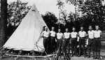 (Thumbnail) Camp Niagara Troops at Fort Mississauga standing by a tent and a pyramid of rifles (image/jpeg)