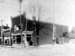 (Thumbnail) A C Thorburn's Drug Store at corner Main Street and Lundy's Lane, Police Station at rear of building (image/jpeg)