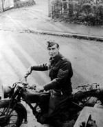(Thumbnail) Sargeant Stewart Amos Rodgers on a motor bike in Epsom Surrey (image/jpeg)