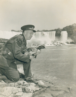(Thumbnail) Conservation Officer A Roy Muma of the Ontario Department of Lands and Forests & Fish & Wildlife Niagara area rescuing an injured duck in the Niagara Gorge (image/jpeg)