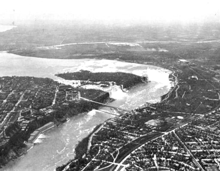 Aerial view of the American and Horseshoe Falls, the Niagara River and the Rainbow Bridge (image/jpeg)