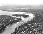 (Thumbnail) Aerial view of the American and Horseshoe Falls, the Niagara River and the Rainbow Bridge (image/jpeg)