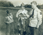 (Thumbnail) Conservation Officer A Roy Muma of the Ontario Department of Lands and Forests & Fish & Wildlife Niagara area showing a young deer to boy scouts (image/jpeg)