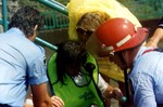 (Thumbnail) Lori Martin being treated after she & Steven Trotter went over the Falls in a barrel (image/jpeg)
