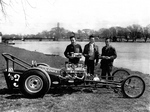 (Thumbnail) Boys standing by a Drag Racer with Chippawa Creek in the background (image/jpeg)