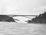 (Thumbnail) American and Horseshoe Falls seen through the arches of the newly constructed Rainbow Bridge (image/jpeg)