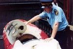 """(Thumbnail) Barrel used by John """"David"""" Munday in his aborted attempt to go over the Horseshoe Falls in 1990 being confiscated by police (image/jpeg)"""