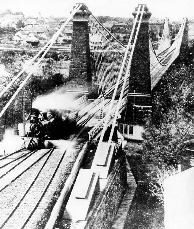 Train on the Railway Suspension Bridge, Clifton in the background circa 1860 (image/jpeg)