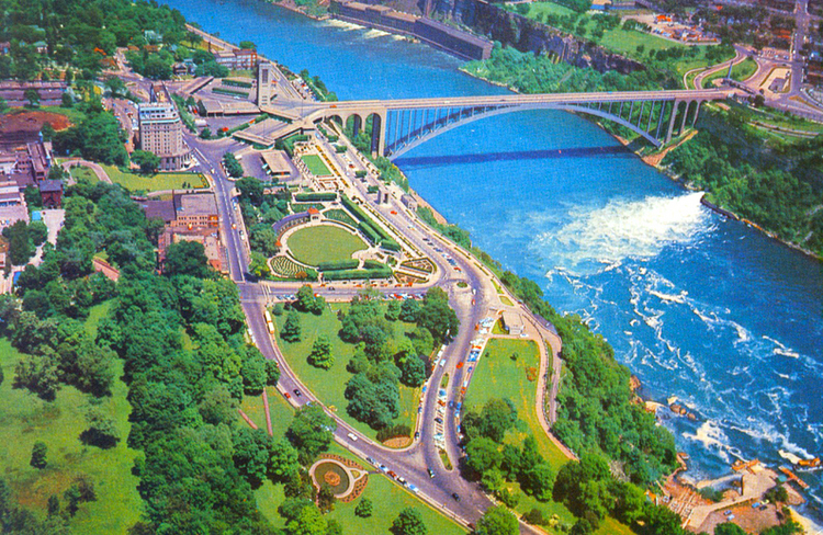 Aerial view showing the Rainbow Bridge with Niagara Falls, Canada on the left and Niagara Falls New York, on the right (image/jpeg)