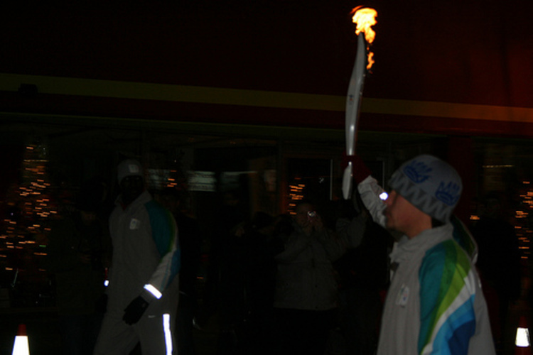 2010 Olympic Torch Relay in Niagara Falls - Torch Being Carried Down Queen Street (image/jpeg)