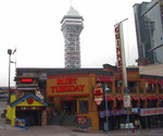 (Thumbnail) Clifton Hill, 4943, Ruby Tuesday Restaurant, Casino Niagara Tower in background (image/jpeg)