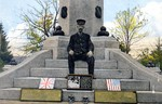 (Thumbnail) William Dalton Caretaker  at Base of the Soldier's Monument Lundy's Lane Battle Ground, Relics of Battle in Foreground (image/jpeg)