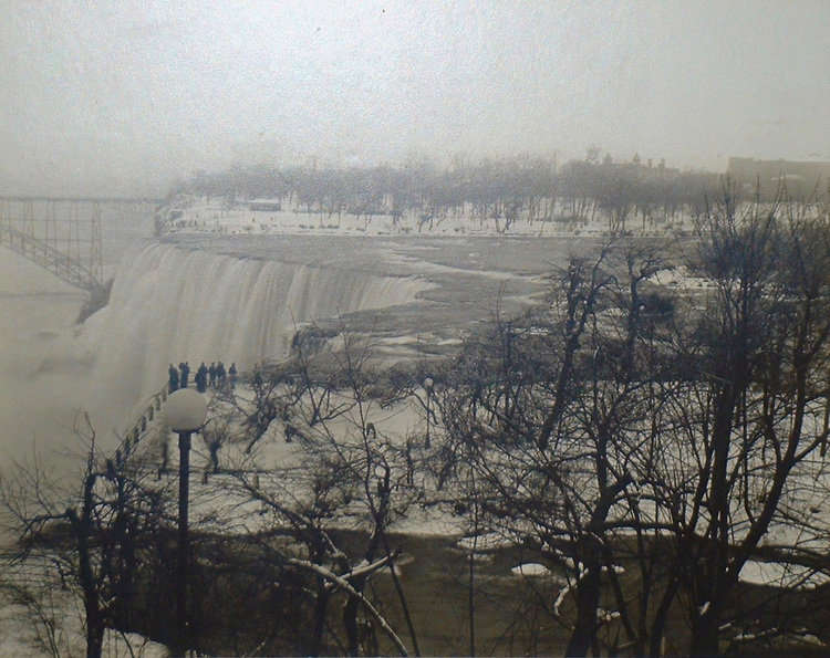 Winter view of the American Falls from Goat island, Honeymoon Bridge in background (image/jpeg)