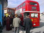 (Thumbnail) Double-Decker tourist bus being used as wedding transportation in front of the IMAX Theater (image/jpeg)
