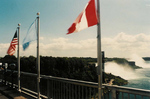 (Thumbnail) Rainbow Bridge Flags with Prospect point Observation Tower American Falls in the Background (image/jpeg)