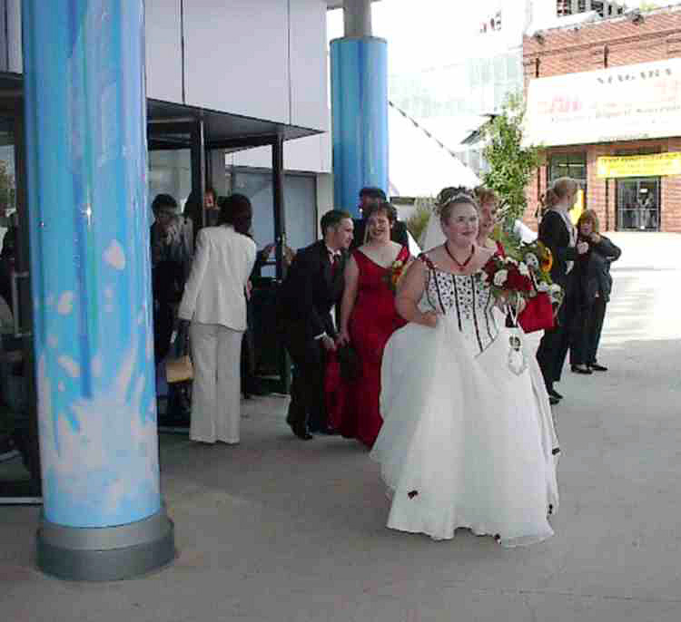 Bride Jennifer Painter leaving her wedding ceremony at the IMAX Theater (image/jpeg)