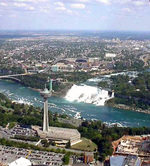 (Thumbnail) Aerial view of the Skylon Tower, the Rainbow Bridge and the American Falls from a helicopter (image/jpeg)