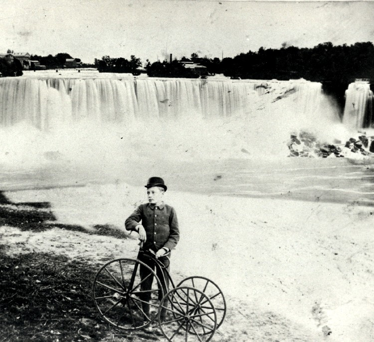 American Falls with cyclist in foreground with his Tricycle (image/jpeg)
