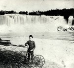(Thumbnail) American Falls with cyclist in foreground with his Tricycle (image/jpeg)