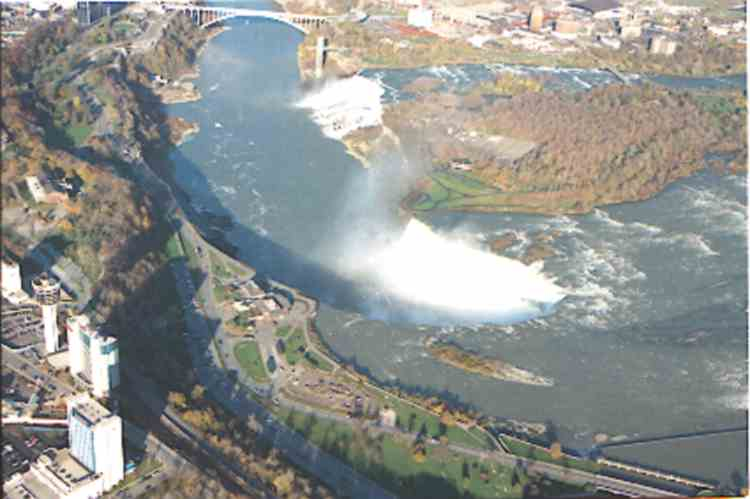 An aerial view of the Horseshoe and American Falls, with the Rainbow Bridge in the background (image/jpeg)