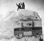 (Thumbnail) Blizzard of 77 - children waving from atop of a buried school bus (image/jpeg)