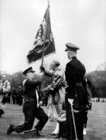 (Thumbnail) Second Lieutenant Ronald William Yorke receiving the Regimental Colour of The Lincoln & Welland... (image/jpeg)