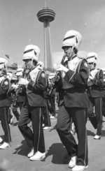 (Thumbnail) Marching band in Queen Victoria Park, Skylon Tower in background (image/jpeg)