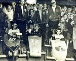 (Thumbnail) 6th annual Optimist Club Soap Box Derby 1963 - winner Gordon Fanstone (centre), Chris Reid (left) in second place and Terry Weller (right) in third place (image/jpeg)
