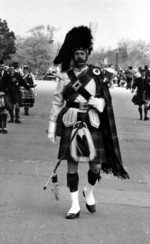(Thumbnail) Band members in a parade through Queen Victoria Park (image/jpeg)