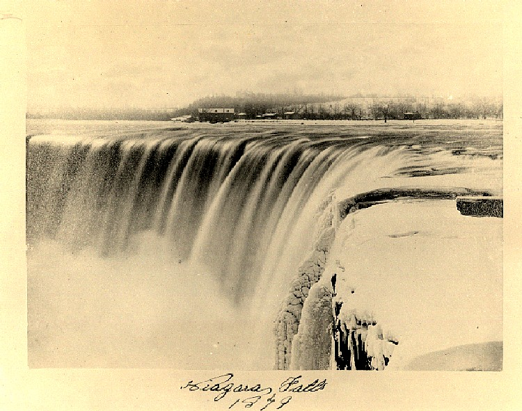 Early photograph of the frozen falls showing Street's Mills in background (image/jpeg)